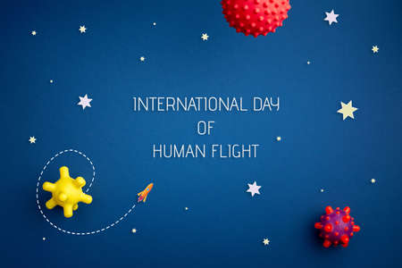 International day of human space flight. 12 April World Cosmonautics Day. Astronaut explores space on a blue isolated background. The concept of distant galaxies and deep space.