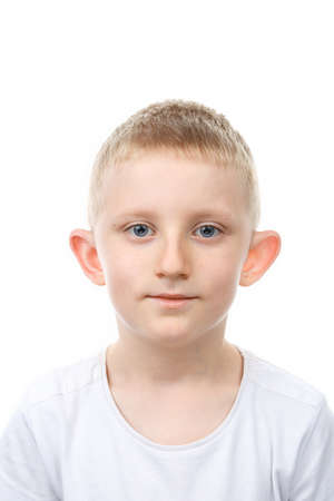 Portrait of little boy on white isolated background. Backlight Photo.