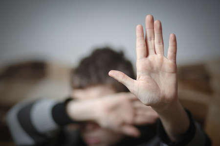 stop hand of child, sign of discrimination or anti violence symbol. Stop abusing violence. Child bondage, violence, terrified, fearful child, Human Rights Day concept.
