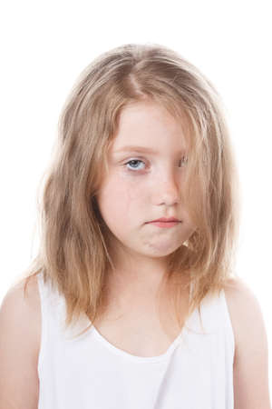little girl with tears in her eyes isolated on white background, the child is crying, the concept of protecting children, the schoolgirl is crying