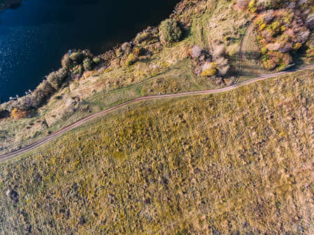 Golden red sunlight AERIAL view, Russia, River, small town, bridge