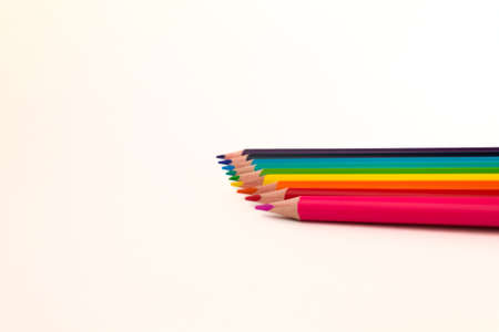 Many multicolored pencils lying together on a white background. Stock Photo