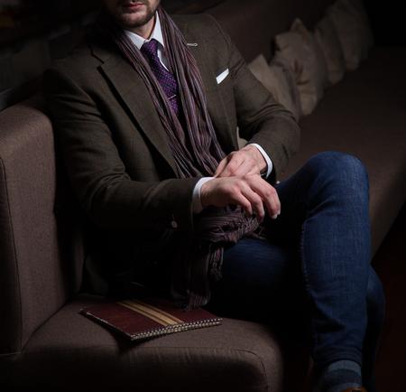 Male model in a suit posing in a restaurant