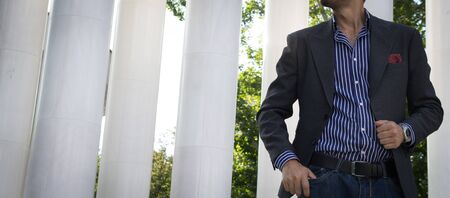 Male model in a suit posing outdoors