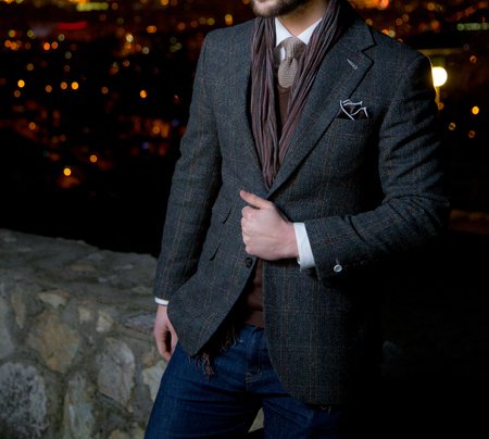 Male model posing with a city panorama in the background