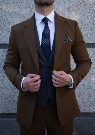 Male model in a suit posing.