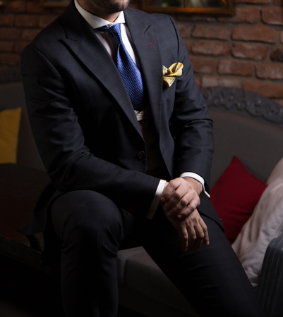 Male model in a suit posing indoors.