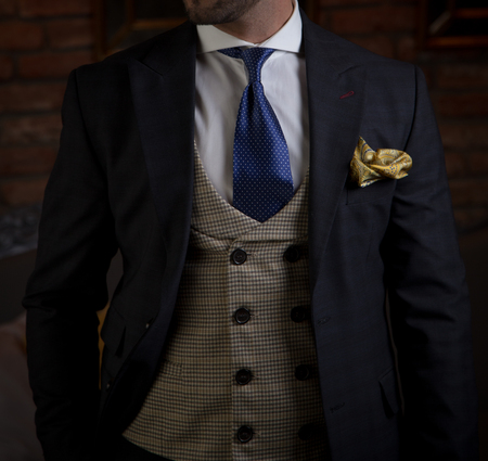 Male model in a three part suit posing