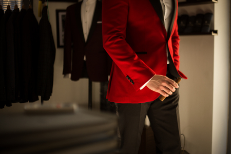 Male model in a red tuxedo with a cigar Imagens