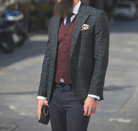 Male model in a three part suit posing outdoors