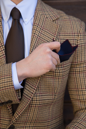 Male model in a suit up-close