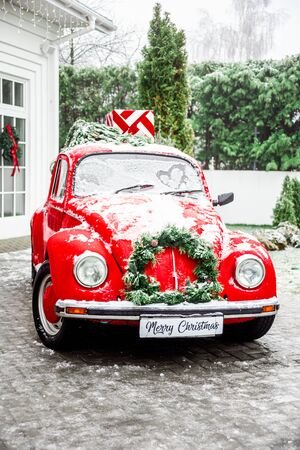 Christmas retro red car with present boxes on top . Cristmas Gifts Concept