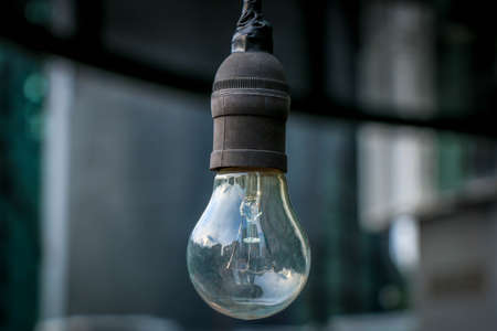 dimm: A light bulb hanging Stock Photo