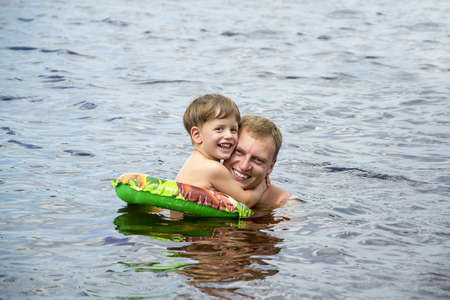 Dad and son swimming photo