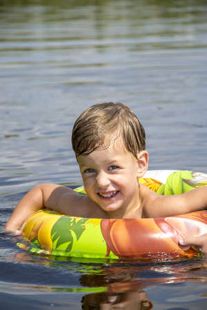 Boy swimming in the water photo