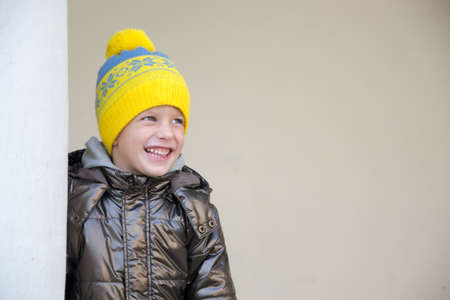 and four of the year: Four year boy wearing warm hat
