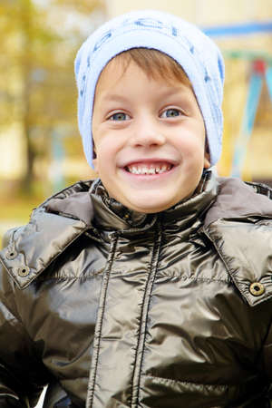 and four of the year: Four year boy in the autumn park wearing a warm hat