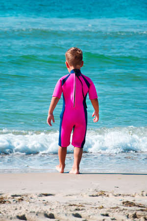 small boy in his diving suit going in water Stock Photo - 38566085