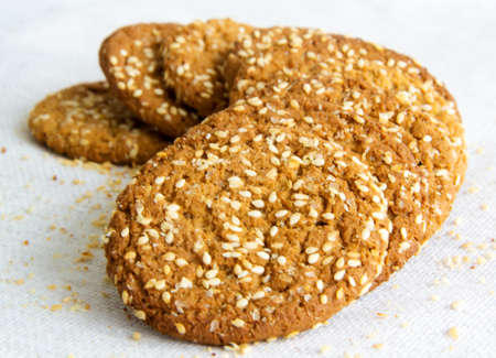 tasty oatmeal cookies with sesame seeds photo