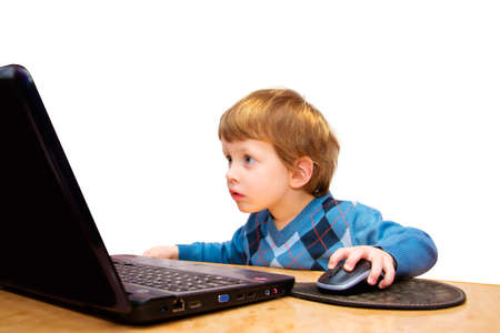Cute three years boy with laptop isolated on white Standard-Bild