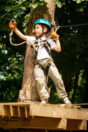 rope bridge: Five year boy on rope-way in the forest