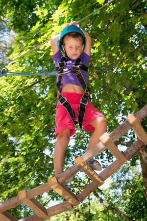 ropeway: Five year boy on rope-way in the forest