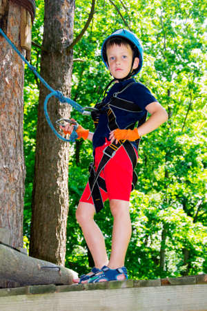 five year: Five year boy on rope-way in the forest