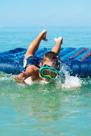 kiddies: boy having fun in sea in swimming mask