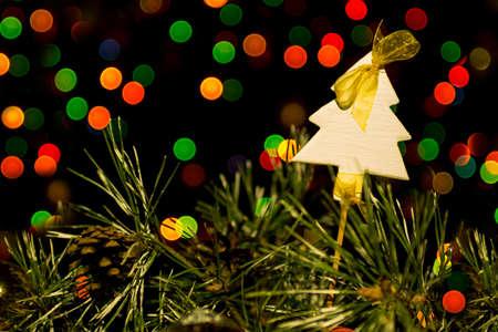 boke: white wooden Christmas tree on lights boke