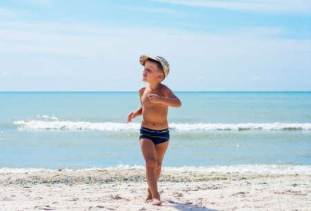 A boy having fun on the beach.