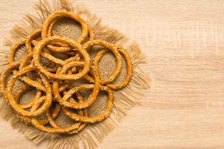 boublik: Bagels with sesame seeds on wooden background. Top view