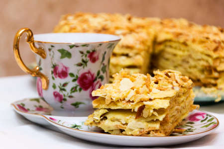 Napoleon cake and cup of tea. Stock Photo