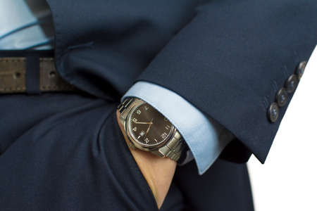 Hand in pocket with wrist watch in a business suit