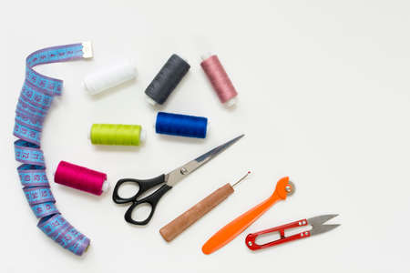 Tailors work desk. Pattern of sewing accessories and tools on white background top view copyspace Stock Photo