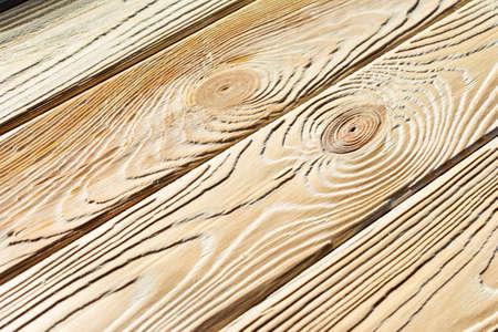 Wood after brashing by angle grinder.
