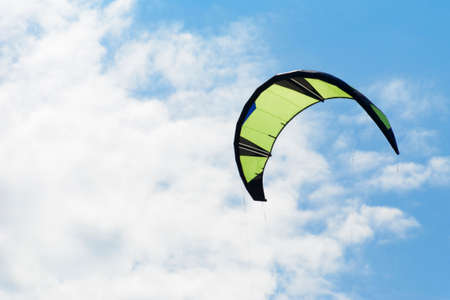 Kiteboarding kite close-up blue sky with clouds in background. Stock Photo