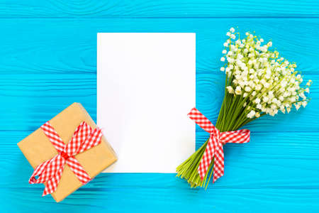 Mothers day. Womens day. Valentines day, Birthday greeting background. Lily of the Valley, envelope, packing gifts. Stock Photo