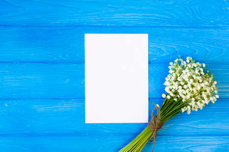 Mockup with bouquet and empty greeting card, gift box top view, copy space for text, flat lay Stock Photo