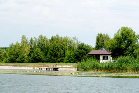 Beautiful wooden bath on the river bank. Weekend house. Eco tourism Standard-Bild