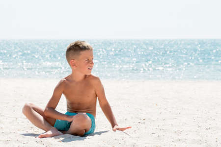 Young boy relaxing on the sea beach. VAcation concept Stock Photo - 122264897