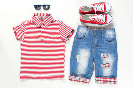 Collage set of children clothes. Concept spring and summer clothes. Close-up. Stock Photo