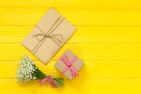 Mockup with bouquet and greeting card, gift box, envelope top view, copy space for text, flat lay Stock Photo - 122265011
