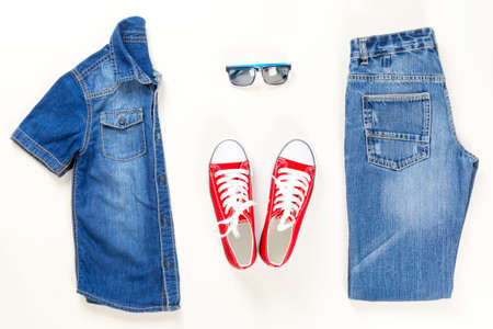 Set of stylish denim clothes, kid trendy fashion clothes collage on white, flat lay, top view Stock Photo - 122265012