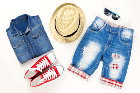 Summer trendy fashion collection of clothes and accessories. Summer outfit of casual denim, sneakers and hat