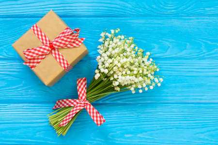 Mockup with bouquet and greeting card, gift box, envelope top view, copy space for text, flat lay Stock Photo - 122265309