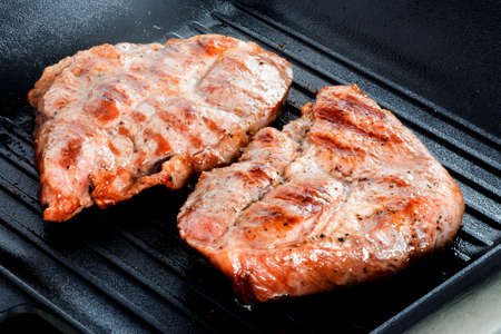Grilled beef Steak on grill pan Stock Photo
