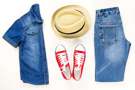 Set of stylish denim clothes, children trendy fashion clothes collage on white, flat lay, top view