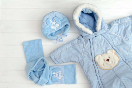 Autumn or winter fashion outfit. Baby boy blue set of clothing on the white background.