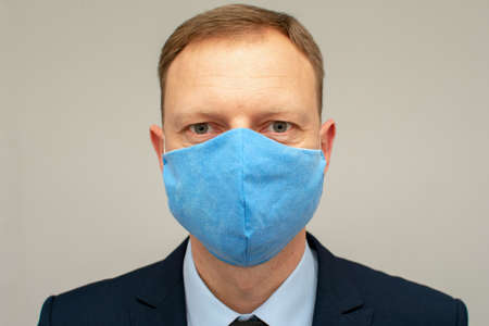 Man wearing mask to prevent corona virus. He wear suit. Protection virus and business concept. Standard-Bild