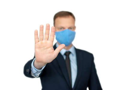 Young businessman with medical mask is showing stop gesture Standard-Bild